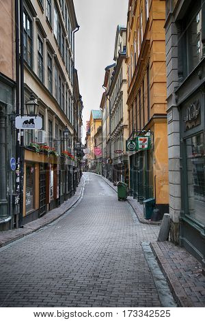 STOCKHOLM SWEDEN - AUGUST 20 2016: View of narrow street and colorful buildings Vasterlanggatan street located in Gamla Stan old town in central Stockholm Sweden on August 20 2016.