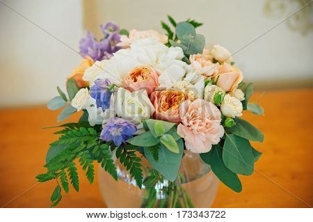 Wedding decorating bouquet of white, pink and orange roses and different petals, closeup