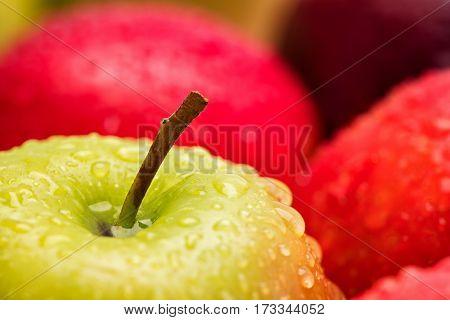 red wet apple with big droplet macro shot