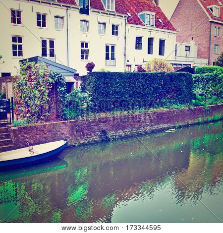 Boat at Berth of the Old Dutch House Located on the Embankment City Of Amersfoort Holland Instagram Effect