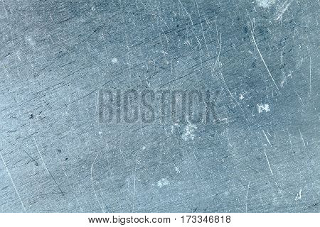Old scratched metal textured background with space for text