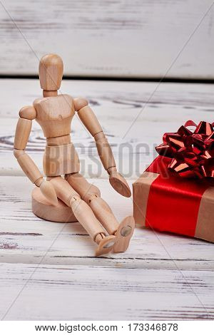 Manikin and wrapped box. Creative present for holiday.