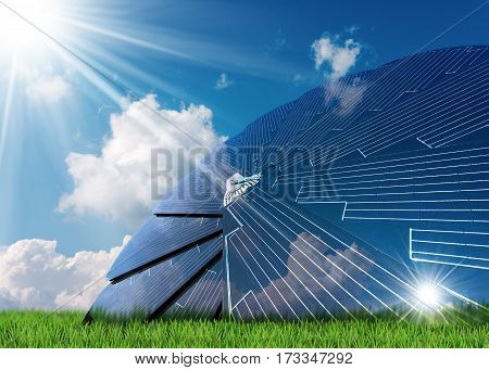 Solar panel in the shape of a flower on a green grass blue sky with clouds and sun rays - Concept of solar energy