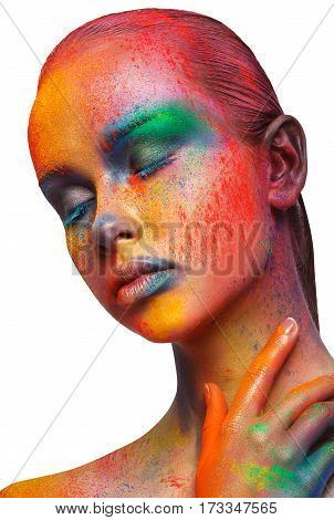 Creative art make up. Closeup studio portrait of young fashion model with bright colorful mix of paint on her face and eyes closed, isolated on white background. Color fantasy, artistic makeup.