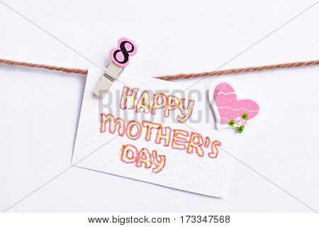 Greeting card on clothesline. Heartful surprise for mother.