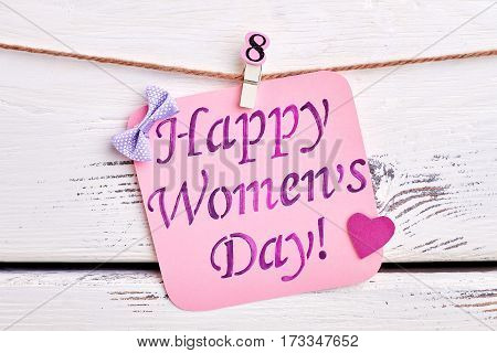 Heart, bow and card. Warm congratulation with Women's day.
