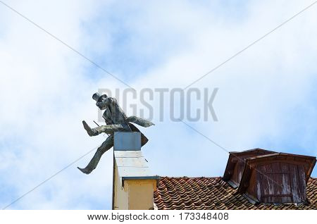 KLAIPEDA LITHUANIA - JULY 11 2015: Monument to chimneysweep on roof Klaipeda Lithuania
