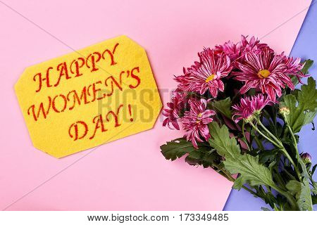 Purple flowers and card. Happy Women's day to you.