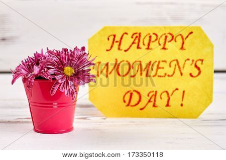 Card and bucket with flowers. Happy Women's day.