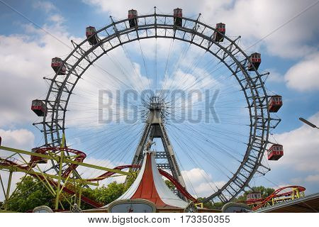 VIENNA AUSTRIA - AUGUST 17 2012: View of Prater giant wheel entrance and Riesenrad ferris wheel in the Prater amusement park in Vienna Austria on August 17 2012.