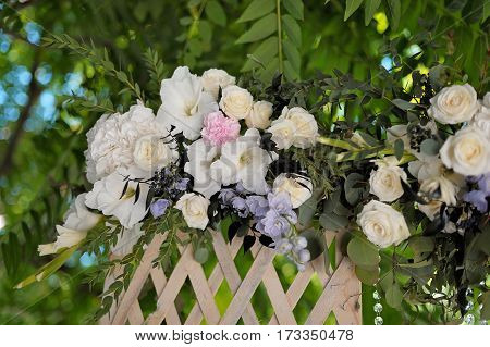Beautiful trellis, decorated with tenderless bouquet, outdoor