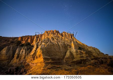 The sandstone cliff of the Black rock beach at half moon bay in the night time, Melbourne, Australia.