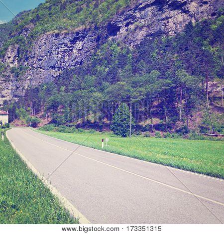 Winding Asphalt Road in the Italian Alps Instagram Effect