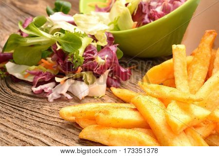 Salad mix with rucola frisee radicchio.carrot lamb's lettuce and fried potatoes
