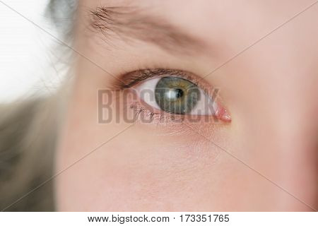Closeup of teenage girl part face portrait looking straight, shallow focus