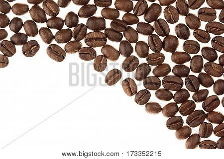 Heap roasted coffee beans as decorative border with copy space isolated on white background.