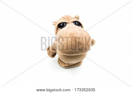 toy hippo is standing on the white background