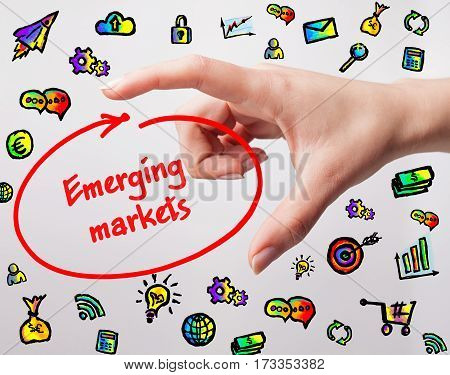 Technology, Internet, Business And Marketing. Young Business Woman Writing Word: Emerging Markets