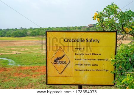 Beware of crocodiles. Caution plate alerting about dangerous predators in water