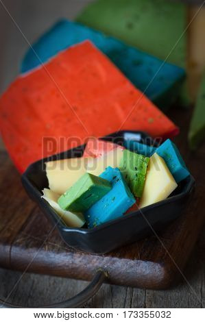 Cheese Mix. Gouda blue green and red cheese on wooden background.
