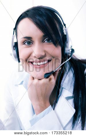 Female Call Center Service Operator At Work. Attractive Female Helpdesk Employee With Headset At Wor