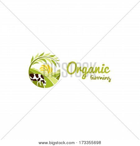 Isolated abstract round shape rural landscape with sun, green meadow and cow logo, organic farming logotype vector illustration