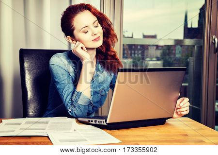 Red-haired Young Business Woman Or Student Girl Working With Doc