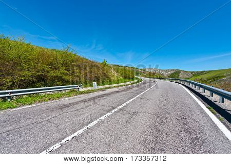 Asphalt Road on the Slopes of the Apennine Mountains in Italy