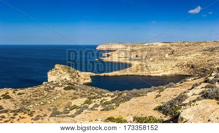 Gozo Malta - Panoramic view of the famous Azure Window with the Fungus rock and Dwejra bay on a beautiful summer day with clear blue sky