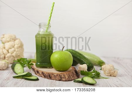 Green Healthy Smoothie And Apple On White Background