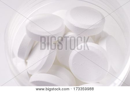 pile of white tablets isolated on white background