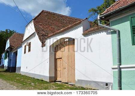 Typical houses in the village Viscri, Transylvania. The fortified church in this village was built around 1100 AD