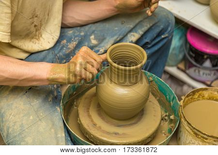 the potter makes earthen vessel close up