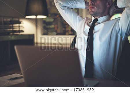 Businessman Thinking At Office