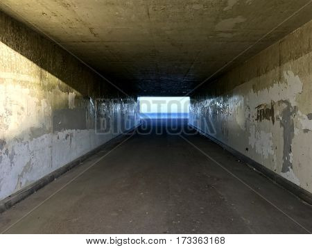 Concrete tunnel by the sea