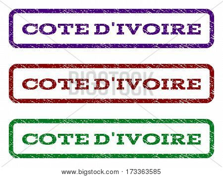 Cote D'Ivoire watermark stamp. Text tag inside rounded rectangle with grunge design style. Vector variants are indigo blue red green ink colors. Rubber seal stamp with unclean texture.
