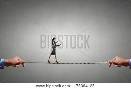 She is walking blindfolded . Mixed media