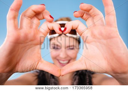 Woman In Ski Goggles Making Heart Symbol Fingers