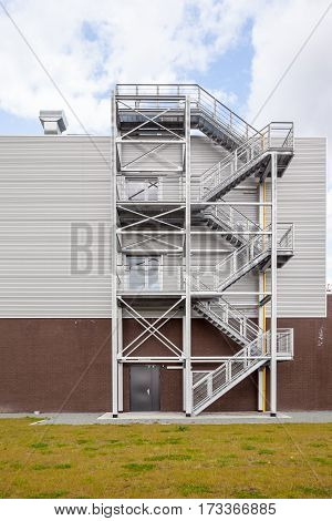 a tall building there is an emergency staircase