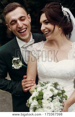 Happy Gorgeous Bride And Stylish Groom Laughing And Having Fun. Emotional Moment Of Beautiful Weddin