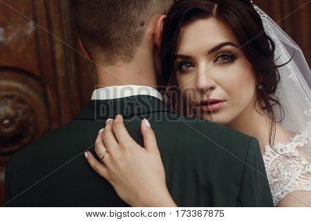 Sensual Beautiful Brunette Bride In White Wedding Dress Hugging Handsome Groom, Portrait, Emotional