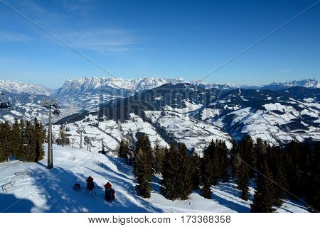 Wagrain Austria - January 30 2017: Valley mountains and cable car nearby Wagrain and Alpendorf in Alps in Austria. Unidentified people visible.