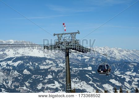 Wagrain Austria - January 30 2017: Cable car nearby Wagrain and Alpendorf in Alps in Austria. Unidentified people visible.
