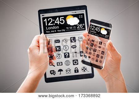 Smart phone (phablet) and tablet with a transparent display in human hands. Concept actual future innovative ideas and best technologies humanity.