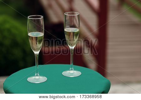 Luxury Glasses Of Champagne On Green Table At Wedding Outdoor Reception And Ceremony. Catering In Re