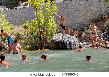 Kemer Antalya Turkey - august 26 2014: Group of tourists swimming in a mountain river canyon Kuzdere during a excursion of the Taurus mountains.