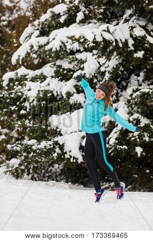 Young Girl Jumping In The Snow.