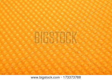 texture of a honeycomb pattern yellow background