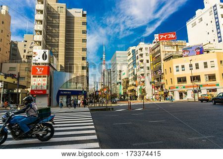 TOKYO JAPAN - OCTOBER 23 2016: City life in Minato Tokyo Japan. The Greater Tokyo Area is the most populous metropolitan near Tokyo tower