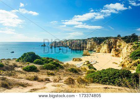 beautiful sea view of sandy beach Pria do Castelo in Algarve region Portugal